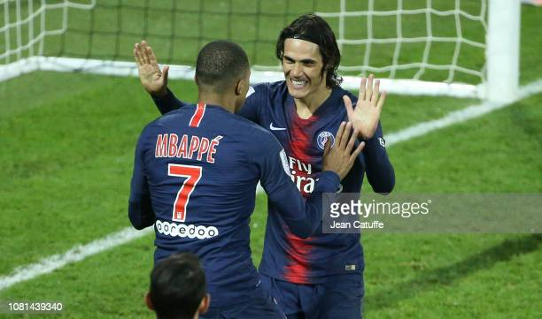Kylian Mbappe of PSG celebrates his goal with Edinson Cavani during the french Ligue 1 match between Amiens SC and Paris Saint Germain at Stade de la...