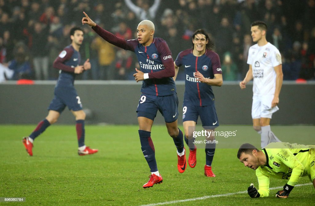 Kylian Mbappe of PSG celebrates his goal with Edinson Cavani while goalkeeper of Caen Remy Vercoutre lies down during the French Ligue 1 match between Paris Saint Germain (PSG) and Stade Malherbe Caen at Parc des Princes on December 20, 2017 in Paris, France.