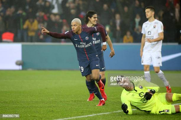 Kylian Mbappe of PSG celebrates his goal with Edinson Cavani while goalkeeper of Caen Remy Vercoutre lies down during the French Ligue 1 match...