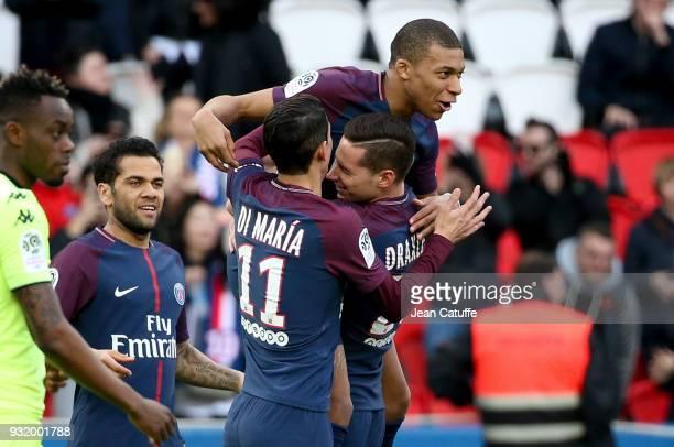 Kylian Mbappe of PSG celebrates his goal with Julian Draxler Angel Di Maria Dani Alves aka Daniel Alves during the French Ligue 1 match between Paris...