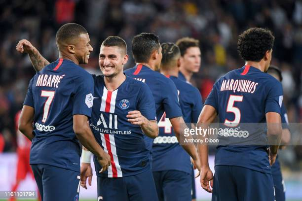 Kylian Mbappe of PSG celebrates his goal with Marco Verratti during the Ligue 1 match between Paris Saint Germain and Nimes at Parc des Princes on...