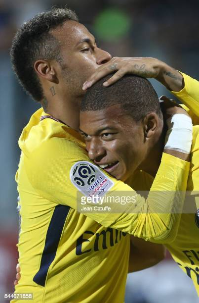 Kylian Mbappe of PSG celebrates his goal with Neymar Jr during the French Ligue 1 match between FC Metz and Paris Saint Germain at Stade...