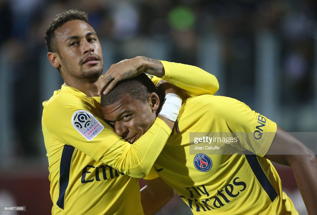 Kylian Mbappe of PSG celebrates his goal with Neymar Jr during the French Ligue 1 match between FC Metz and Paris Saint Germain (PSG) at Stade Saint-Symphorien on September 9, 2017 in Metz, France.
