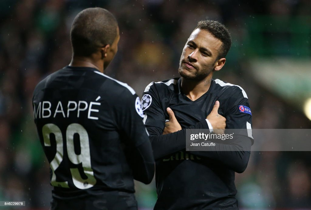 Kylian Mbappe of PSG celebrates his goal with Neymar Jr (right) during the UEFA Champions League match between Celtic Glasgow and Paris Saint Germain (PSG) at Celtic Park on September 12, 2017 in Glasgow, Scotland.