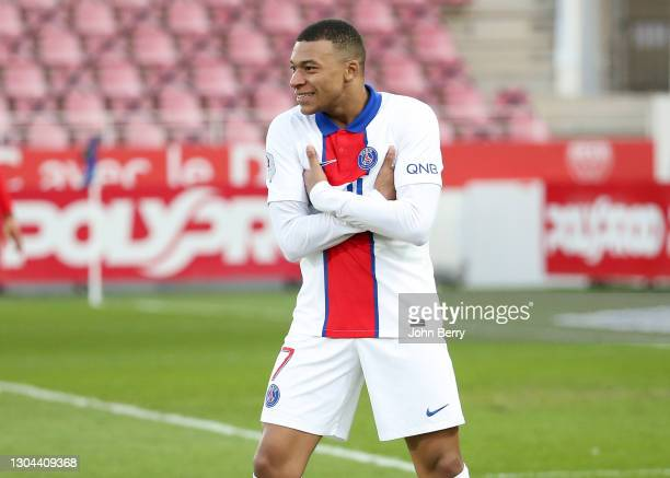 Kylian Mbappe of PSG celebrates his second goal during the Ligue 1 match between Dijon FCO and Paris Saint-Germain at Stade Gaston Gerard on February...