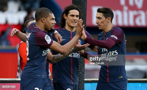 Kylian Mbappe of PSG celebrates his second goal with Layvin Kurzawa Edinson Cavani Angel Di Maria during the French Ligue 1 match between Paris Saint...