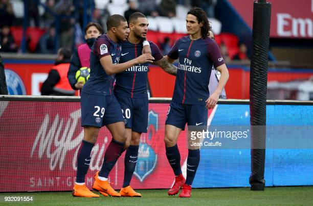 Kylian Mbappe of PSG celebrates his second goal with Layvin Kurzawa Edinson Cavani during the French Ligue 1 match between Paris Saint Germain and...