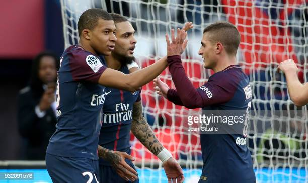 Kylian Mbappe of PSG celebrates his second goal with Layvin Kurzawa Marco Verratti during the French Ligue 1 match between Paris Saint Germain and...