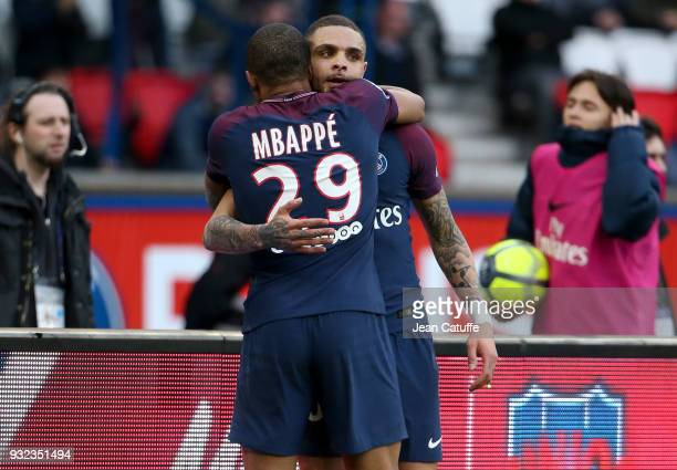 Kylian Mbappe of PSG celebrates his second goal with Layvin Kurzawa during the French Ligue 1 match between Paris Saint Germain and SCO Angers at...