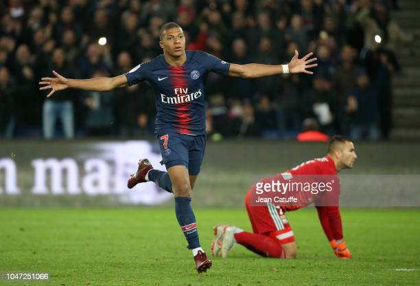 Kylian Mbappe of PSG celebrates his third goal while goalkeeper of Lyon Anthony Lopes looks on during the french Ligue 1 match between Paris...