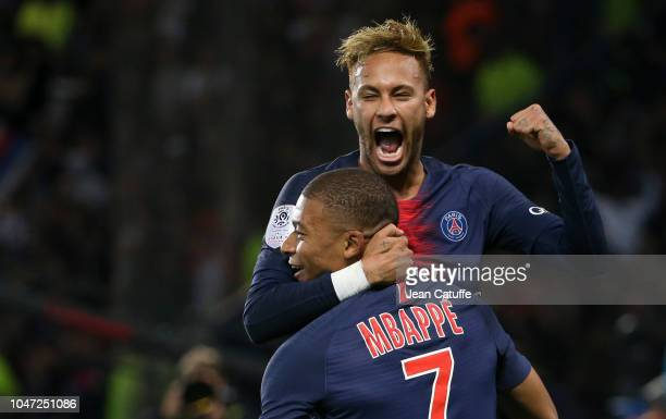 Kylian Mbappe of PSG celebrates his third goal with Neymar Jr during the french Ligue 1 match between Paris SaintGermain and Olympique Lyonnais at...