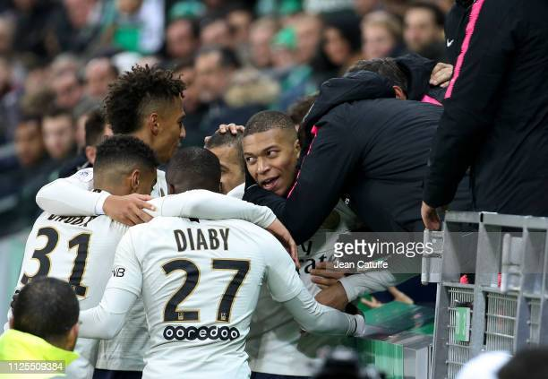 Kylian Mbappe of PSG celebrates his winning goal with teammates during the French Ligue 1 match between AS Saint-Etienne and Paris Saint-Germain at...