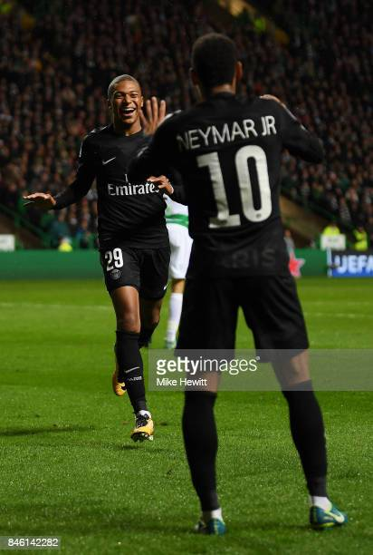 Kylian Mbappe of PSG celebrates scoring his sides second goal with Neymar of PSG during the UEFA Champions League Group B match between Celtic and...