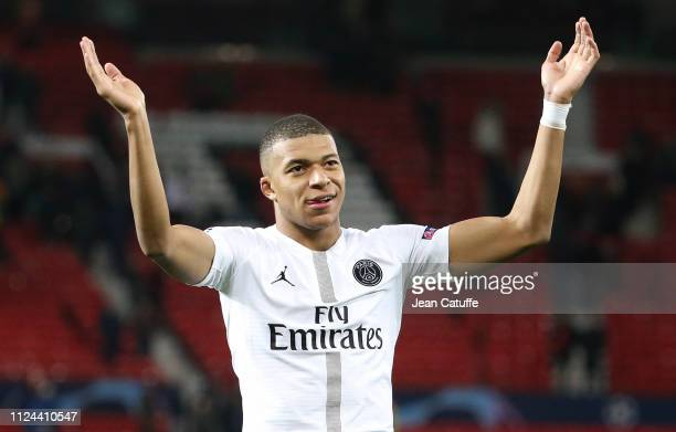 Kylian Mbappe of PSG celebrates the victory following the UEFA Champions League Round of 16 First Leg match between Manchester United and Paris...