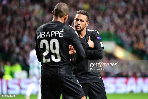 Kylian Mbappe of PSG celebrates with Neymar JR of PSG after he puts his side 20 ahead during the Uefa Champions League match between Glasgow Celtic...