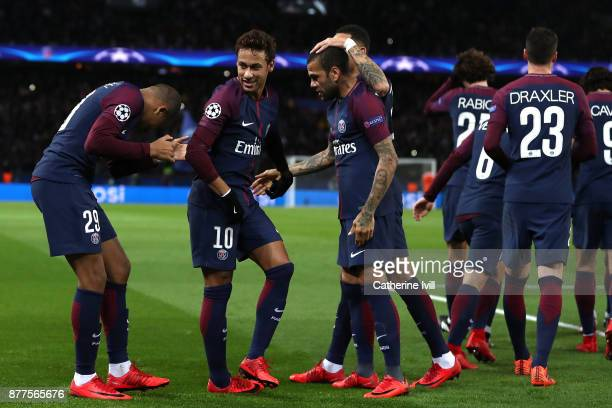 Kylian Mbappe of PSG celebrates with teammates after scoring his sides fourth goal during the UEFA Champions League group B match between Paris...