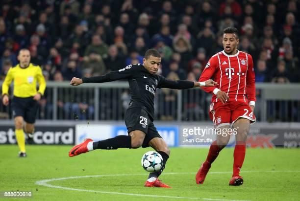 Kylian Mbappe of PSG Corentin Tolisso of Bayern Munich during the UEFA Champions League group B match between Bayern Muenchen and Paris SaintGermain...