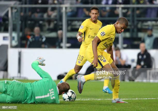 Kylian Mbappe of PSG goalkeeper of Anderlecht Matz Sels during the UEFA Champions League match between RSC Anderlecht and Paris Saint Germain at...