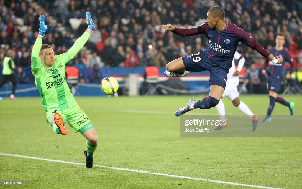 Kylian Mbappe of PSG, goalkeeper of Guingamp Karl-Johan Johnsson (left) during the Ligue 1 match between Paris Saint Germain (PSG) and En Avant Guingamp at Parc des Princes stadium on April 29, 2018 in Paris, .