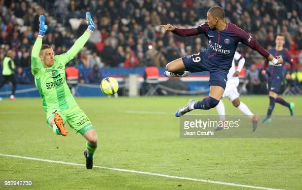 Kylian Mbappe of PSG goalkeeper of Guingamp KarlJohan Johnsson during the Ligue 1 match between Paris Saint Germain and En Avant Guingamp at Parc des...