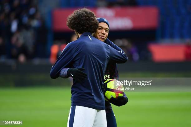 Kylian Mbappe of PSG greets former PSG youth team player Yacine Adli of Bordeaux before the Ligue 1 match between Paris Saint Germain and Bordeaux at...