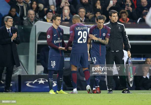 Kylian Mbappe of PSG greets Giovani Lo Celso when he's replaced by Angel Di Maria during the UEFA Champions League group B match between Paris...