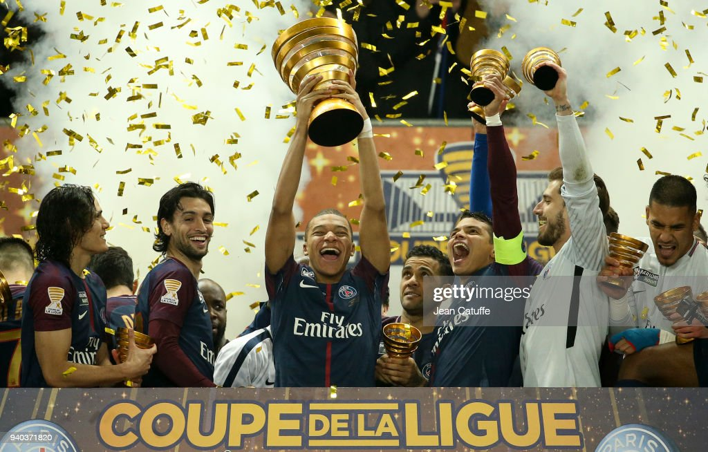 Kylian Mbappe of PSG holds the trophy and celebrates the victory between Edinson Cavani, Javier Pastore, Thiago Silva, Kevin Trapp following the French League Cup (Coupe de la Ligue) final between Paris Saint-Germain (PSG) and AS Monaco on March 31, 2018 in Bordeaux, France.