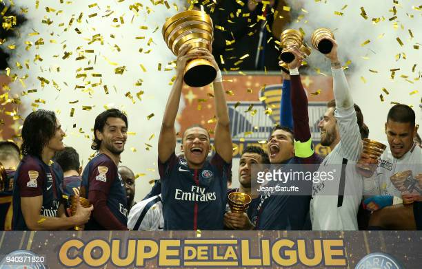 Kylian Mbappe of PSG holds the trophy and celebrates the victory between Edinson Cavani Javier Pastore Thiago Silva Kevin Trapp following the French...