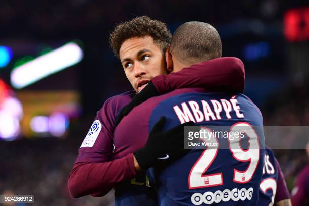 Kylian Mbappe of PSG is congratulated by Neymar JR of PSG after putting their side 10 ahead during the Ligue 1 match between Paris Saint Germain and...