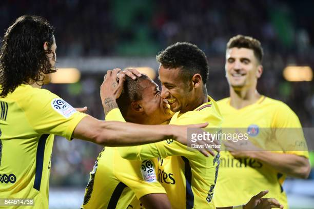 Kylian Mbappe of PSG is congratulated by Neymar JR of PSG and Edinson Cavani of PSG after putting their side 21 ahead during the Ligue 1 match...