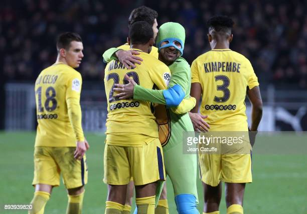 Kylian Mbappe of PSG is hugged by a pitch invader disguised as Ninja Turtle during the French Ligue 1 match between Stade Rennais and Paris Saint...