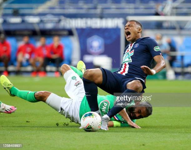Kylian Mbappe of PSG is seriously injured on his right ankle by Loic Perrin of Saint-Etienne with this dangerous tackle during the French Cup Final...