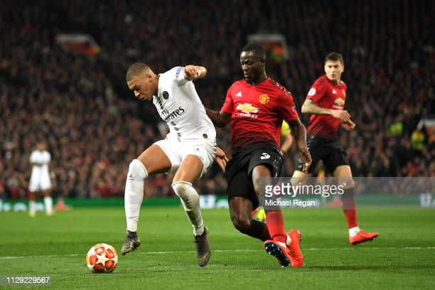 Kylian Mbappe of PSG is tackled by Eric Bailly of Manchester United during the UEFA Champions League Round of 16 First Leg match between Manchester...