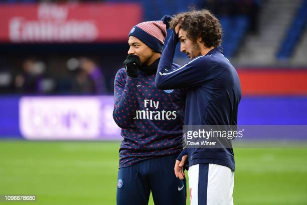 Kylian Mbappe of PSG jokes with former PSG youth team player Yacine Adli of Bordeaux before the Ligue 1 match between Paris Saint Germain and...