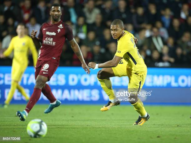 Kylian Mbappe of PSG Miguel Cafu of FC Metz during the French Ligue 1 match between FC Metz and Paris Saint Germain at Stade SaintSymphorien on...