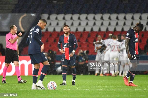 Kylian MBAPPE of PSG NEYMAR JR of PSG and Moise KEAN of PSG look dejected during the UEFA Champions League match between Paris Saint Germain and...