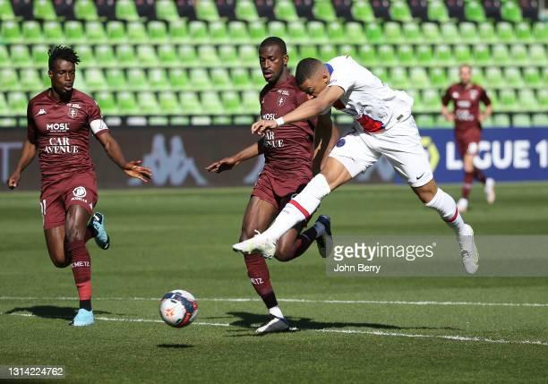 Kylian Mbappe of PSG scores his first goal despite Boubakar Kouyate, John Boye of FC Metz during the Ligue 1 match between FC Metz and Paris...