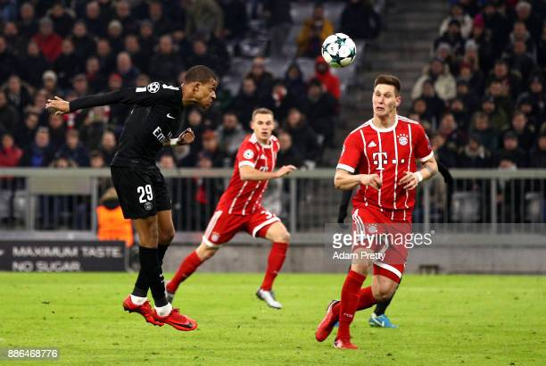 Kylian Mbappe of PSG scores his sides first goal during the UEFA Champions League group B match between Bayern Muenchen and Paris SaintGermain at...