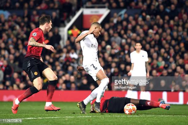 Kylian Mbappe of PSG scores his sides second goal during the UEFA Champions League Round of 16 First Leg match between Manchester United and Paris...