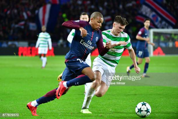 Kylian Mbappe of PSG takes on Kieran Tierney of Celtic during the UEFA Champions League match between Paris Saint Germain and Glasgow Celtic at Parc...