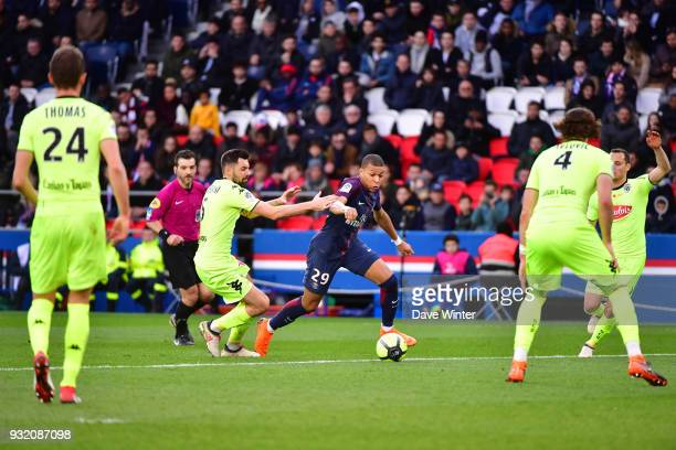 Kylian Mbappe of PSG takes on the opposition defence during the Ligue 1 match between Paris Saint Germain and Angers SCO on March 14 2018 in Paris...