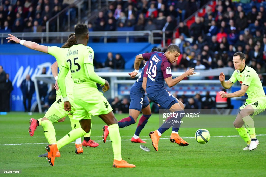 Kylian Mbappe of PSG takes on the opposition defence during the Ligue 1 match between Paris Saint Germain (PSG) and Angers SCO on March 14, 2018 in Paris, France.