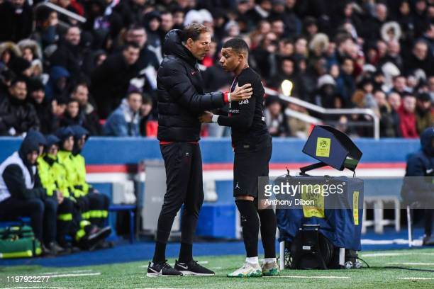 Kylian MBAPPE of PSG talks with Thomas TUCHEL coach of PSG during the Ligue 1 match between Paris and Montpellier at Parc des Princes on February 1...