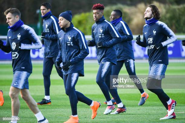 Kylian Mbappe Presnel Kimpembe and Adrien Rabiot of France during training session at Centre National du Football on March 20 2018 in Clairefontaine...