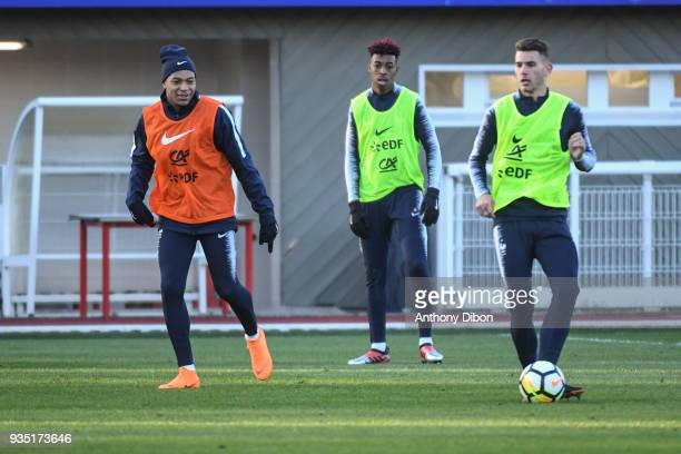 Kylian Mbappe Presnel Kimpembe and Lucas Hernandez of France during training session at Centre National du Football on March 20 2018 in...