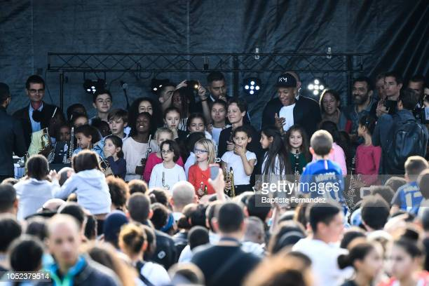 Kylian Mbappe react while youngs musician play the French national Anthem during the return of UEFA Soccer World Champion Kylian Mbappe to his...
