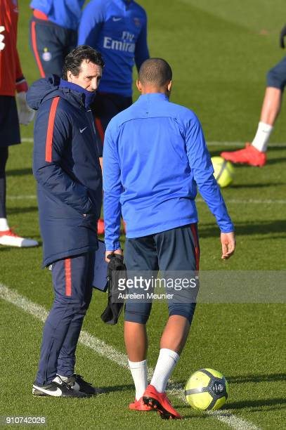 Kylian Mbappe speaks with Head Coach Unai Emery as he arrives for a training session of Paris Saint Germain PSG at Camp des Loges on January 26 2018...
