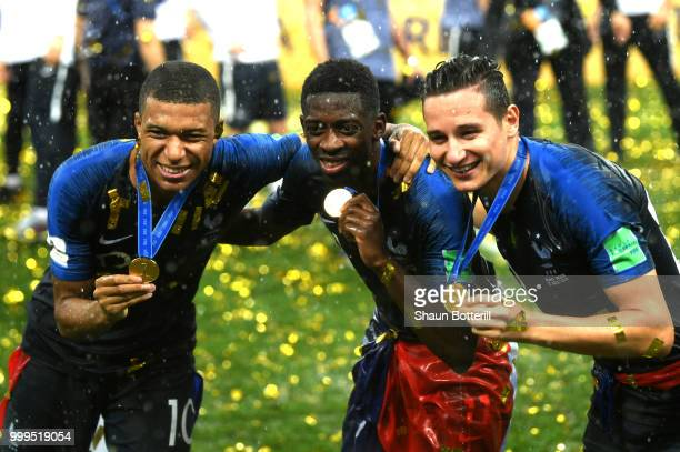 Kylian Mbappe Thomas Lemar and Florian Thauvin of France show their medals following victory in the 2018 FIFA World Cup Final between France and...