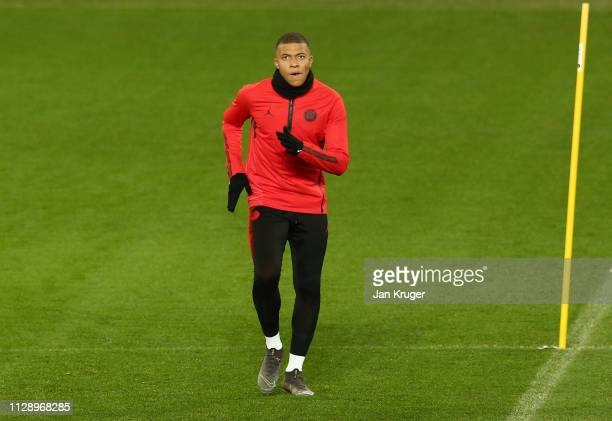 Kylian Mbappe warms up during a Paris SaintGermain training session at Old Trafford on February 11 2019 in Manchester England