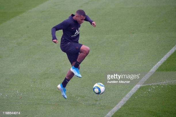 Kylian Mbappe warms up during a PAris SaintGermain training session at Centre Ooredoo on August 17 2019 in Paris France